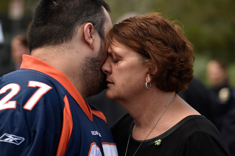 """Terry Sullivan, right, mother of Aurora theater shooting victim Alex Sullivan, hugs Bryan Beard, left, Alex's best friend outside of  the Arapahoe County Justice Center in Centennial, Colorado on  August 7, 2015.  (Photo By Helen H. Richardson/ The Denver Post)"""