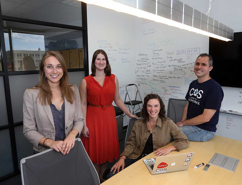 Staff of the the Reproducibility Project at the Center for Open Science in Charlottesville, Va., from left: Mallory Kidwell, Courtney Soderberg, Johanna Cohoon and Brian Nosek. Dr. Nosek and his team led an attempt to replicate the findings of 100 social science studies. Credit Andrew Shurtleff for The New York Times