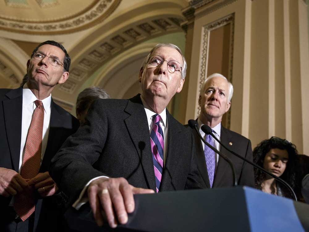 Senate Majority Leader Mitch McConnell of Ky., with Senate Minority Whip John Cornyn of Texas, right, and Sen. John Barrasso, R-Wyo., left (AP Photo/J. Scott Applewhite)