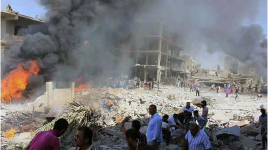 People in Syria watch where the attack took place in horror, after 44 casualties have been confirmed so far by authorities in the city of Qamishli. Image Credit: BBC