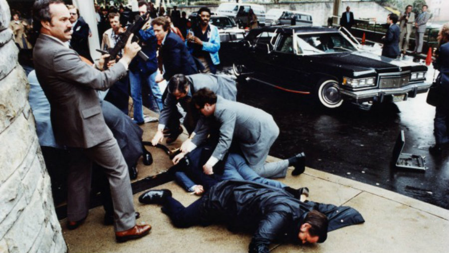 A photo of the moment when Hinckley shot at President Reagan on March 30, 1981. Fortunately for Reagan, Hinckley's shot didn't get to him, yet it was a close call. Image Credit: Stuff