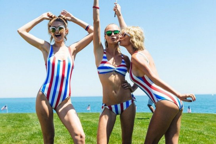 A picture from Cara Delevigne's Instagram account with Kesha and Taylor Swift in their 4th of July swimsuits. Image Credit: Teen Vogue