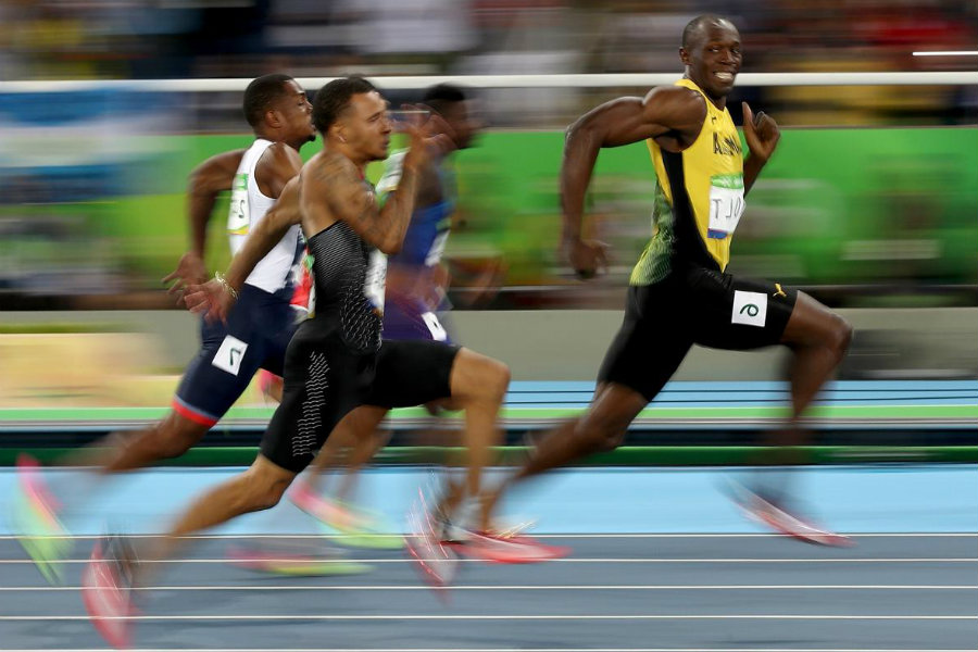 Bolt not only won the race with an amazing velocity in the last meters of the 100m race, but he also had time to look at the camera and vitoring. Image Credit: Slate