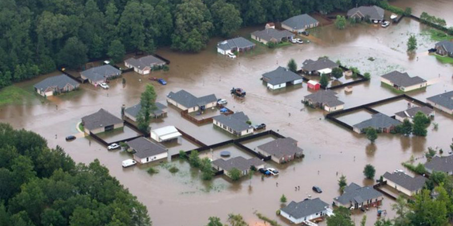 This aerial photo shows flooded homes along the Tangipahoa River near Amite, Louisiana. Image Credit: Business Insider