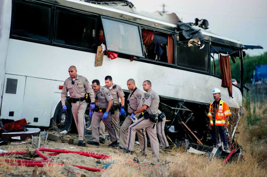 "Californian authorities investigate the site of the crash on Interstate (#$/"" to determine what happened and what could've caused the bus to crash in such aggresive manner. Image Credit: Chron"