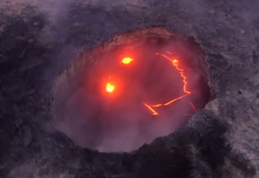 Interestingly enough, the Kilauea volcano has shown a lighter side than most volcanoes given the smiley face made by hot lava appearing at the top. Image Credit: Daily Mail