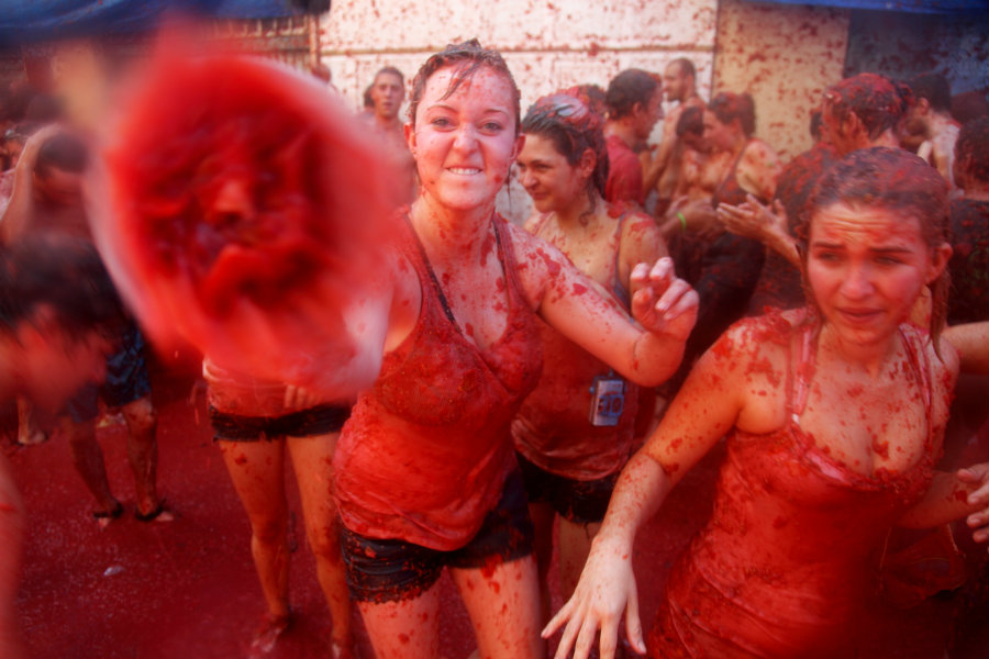 Over a hundred tons of fresh tomatoes arrived early Wednesday to provide enough ammo for the thousands of participants. Photo credit: LaTomatina.org