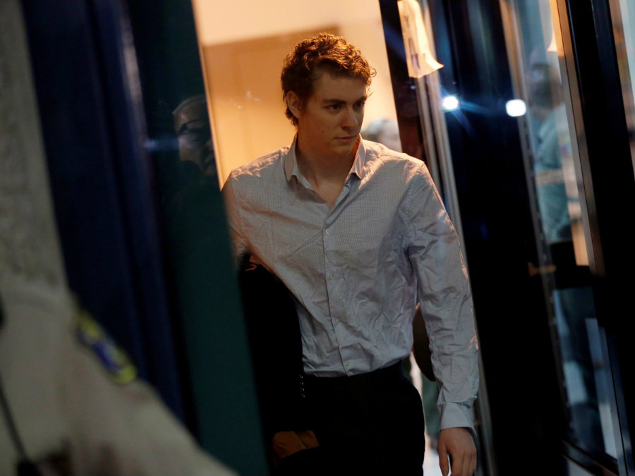 Brock Turner left the Santa Clara County jail wearing a white, long-sleeved shirt with a paper bag containing his belongings and a sports jacket under his arm. Photo credit: Reuters / Stephen Lam / Business Insider