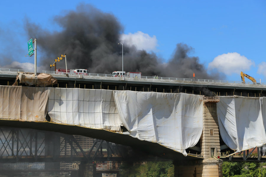 The Liberty Bridge caught fire while people worked on a renovation project, causing significant damages that weakened the massive structure. Photo credit: Margaret J. Krauss / 90.5 WESA