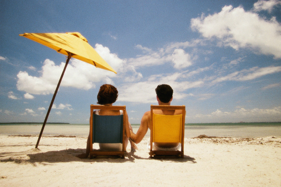 Use sunscreens instead of umbrellas at the beach A lot of people carry umbrellas to protect themselves from the sun. Photo credit: LocateADoc.com