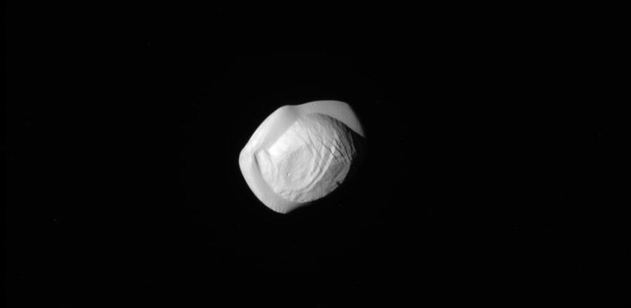 Pan is the second innermost of Saturn's known moons. Image credit: NASA / JPL-Caltech, via Space Science Institute / The New York Times