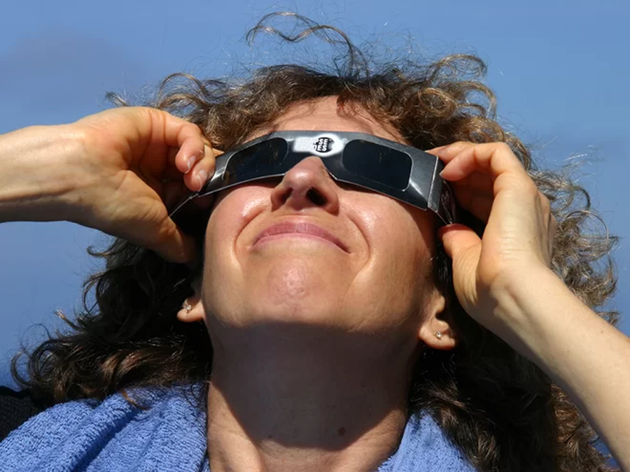 Make sure that your eclipse glasses are safe before watching the solar eclipse. Image Credit: Evan Zucker