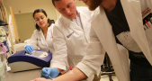 Daniel Gallego-Perez, Ph.D. demonstrating tissue nanotransfection, using a silicone chip to convert skin cells into other types of cells. Image Credit: The Ohio State University Wexner Medical Center