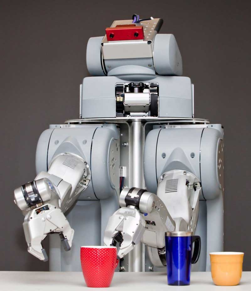The robots, called PR2, have coolers attached to them and are programmed to roam around separate rooms and go ask people if they want a drink. Should the person say yes, the silicone-powered bartender wheels over to a larger robot that places a beer in the cooler, and returns it to the customer. Image Wikipedia.