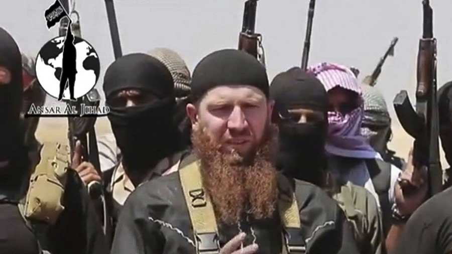 Omar al-Shishani, a Chechen jihadist, among a group of ISIL fighters as they declare the elimination of the border between Iraq and Syria. The screenshot was taken from a video posted on a social media account frequently used for ISIL communications. IMAGE: Militant Social  Media Account Via AP VIDEO/ASSOCIATED PRESS