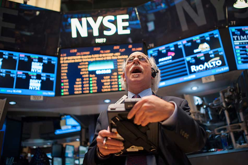 A trader works on the floor of the New York Stock Exchange at the Closing Bell in New York, New York, USA, 05 March 2013. EPA
