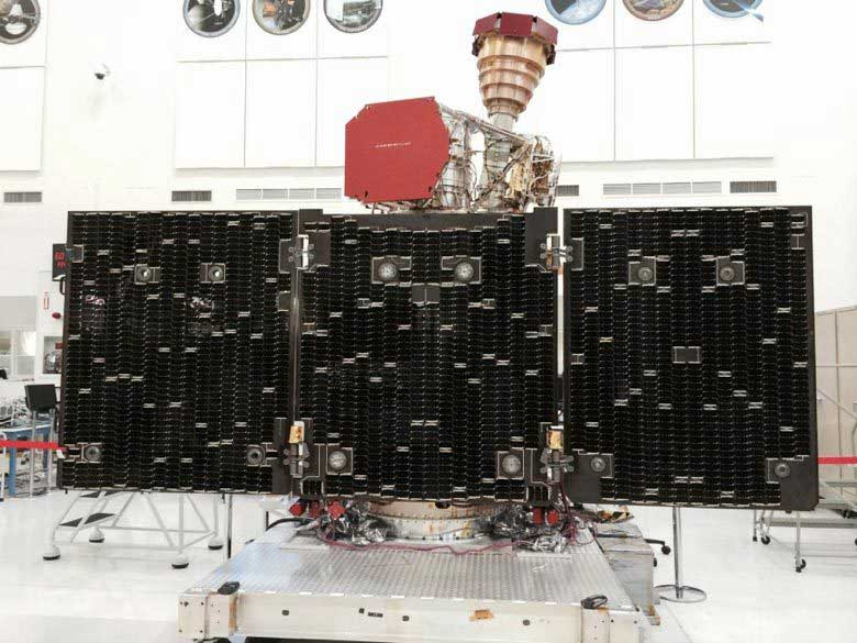The unfolded solar arrays to power SMAP and the golden feedhorn for its radar and radiometer are visible in this image taken during assembly and testing. Credits: NASA