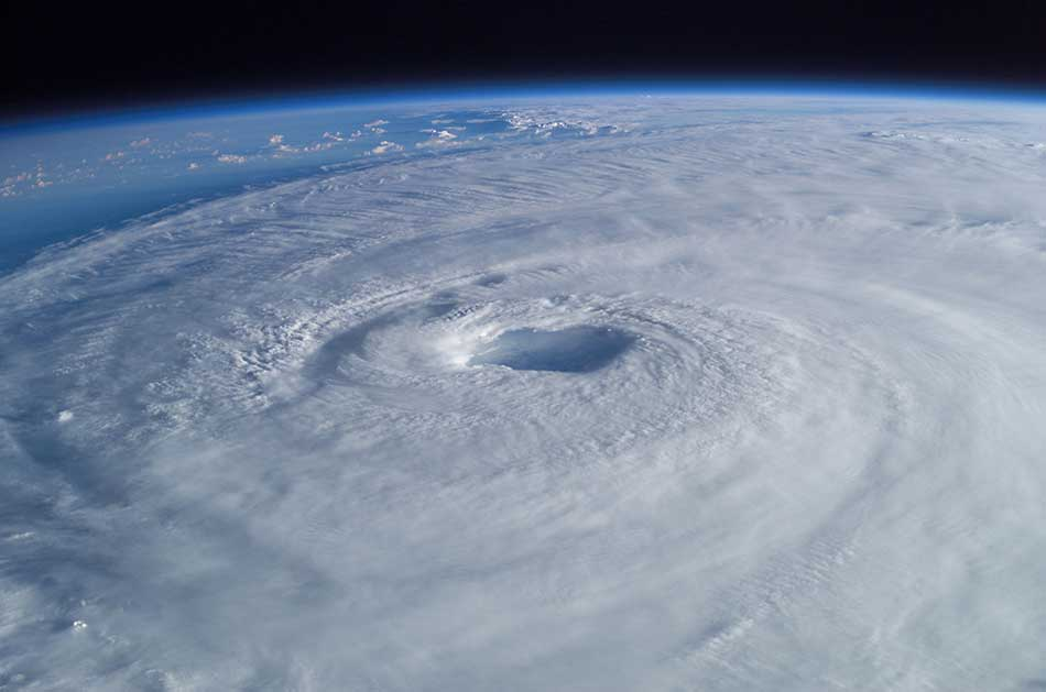 Hurricane Isabel (2003) as seen from orbit during Expedition 7 of the International Space Station. The eye, eyewall, and surrounding rainbands, characteristics of tropical cyclones, are clearly visible in this view from space. Credit: Wikipedia