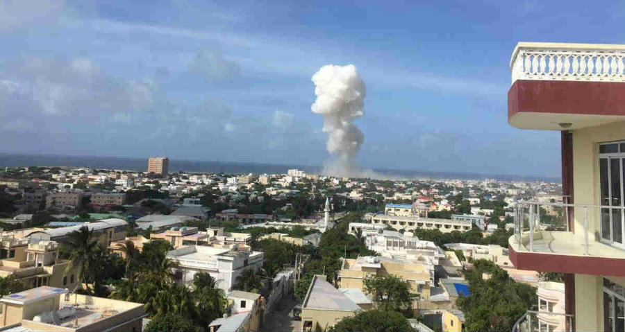 A picture taken far away from the dual car bombing attack's ground zero. The attack credited to Al-Shabab took the lives of thirteen people who were transitting at the time. Image Credit: Twitter
