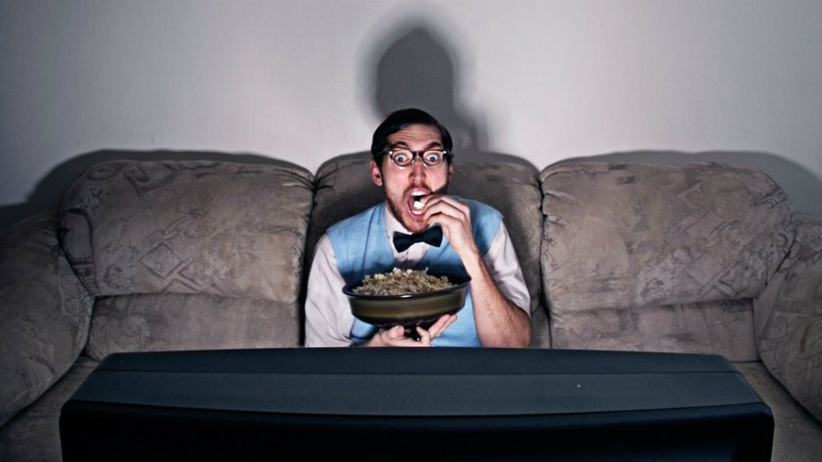People who spend plenty of time in front of their TVs binge watching their favorite series could be harming themselves by establishing a sedentarian routine. Image Credit: Geek & SunDry