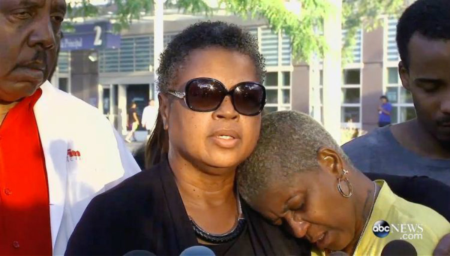 Wade's mother, pastor Jolinda Wade, consoled the victim's devastated mother, her sister Diann. Image Credit: Daily News