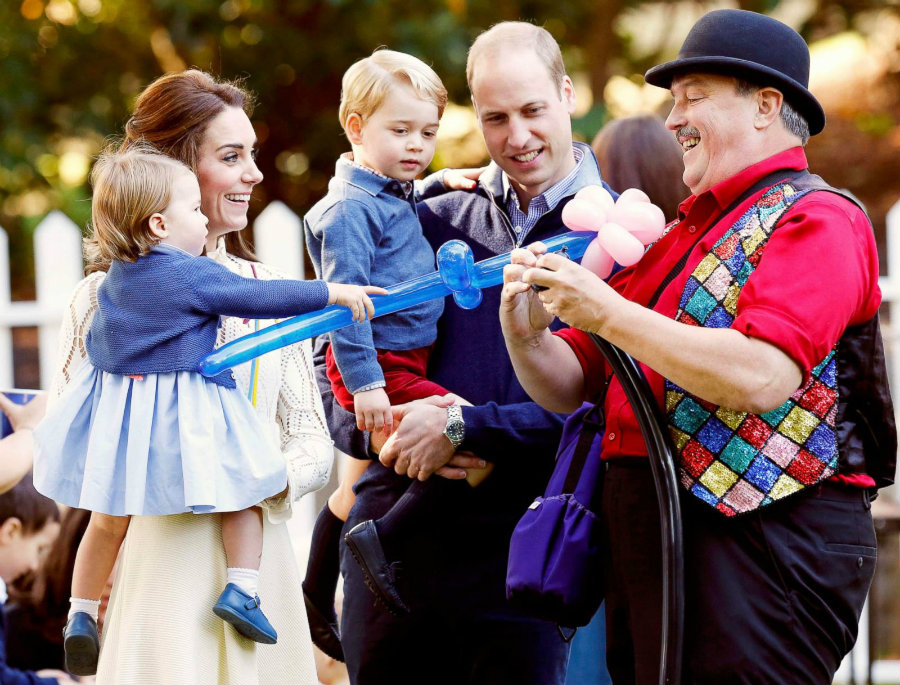Prince William and Duchess Kate of Cambridge were seen in the back of a Government House in British Columbia, Canada, as they played with their two young children. Photo credit: ABC News
