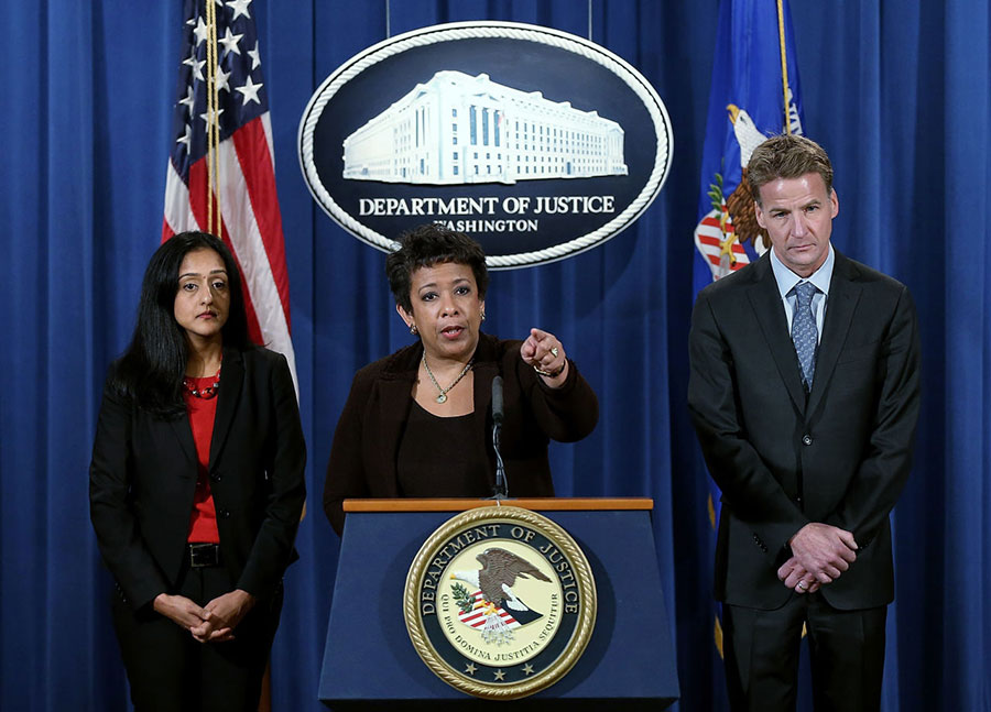 U.S. Attorney General Loretta Lynch (center) speaks during a press conference at the Department of Justice December 7, 2015 in Washington, DC. Image credit: Win McNamee/Getty Images/WBUR