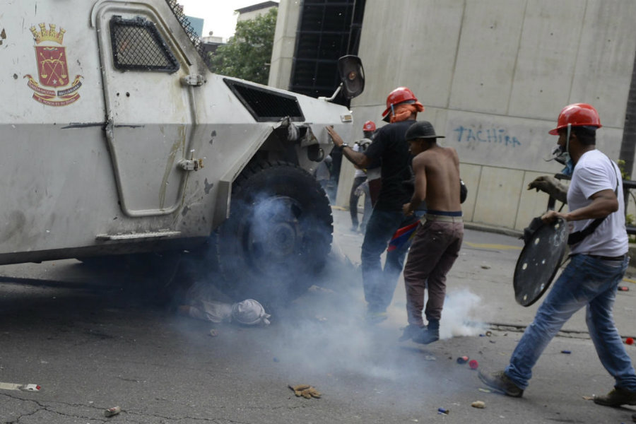 On Wednesday, during a clash between the National Guard and opposition masked protesters in Altamira, a neighborhood in Caracas, an armored tank ran over one of the protesters. Image credit:  Federico Parra / Getty Images / Univision