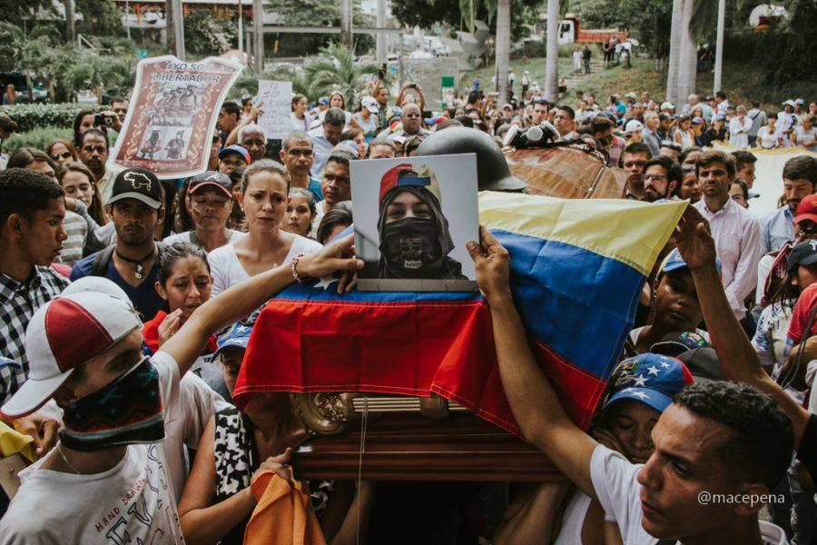 Neomar Lander's coffin, one of the boys killed in the protests. Image credit: María Cecilia Peña, Pulse Headlines