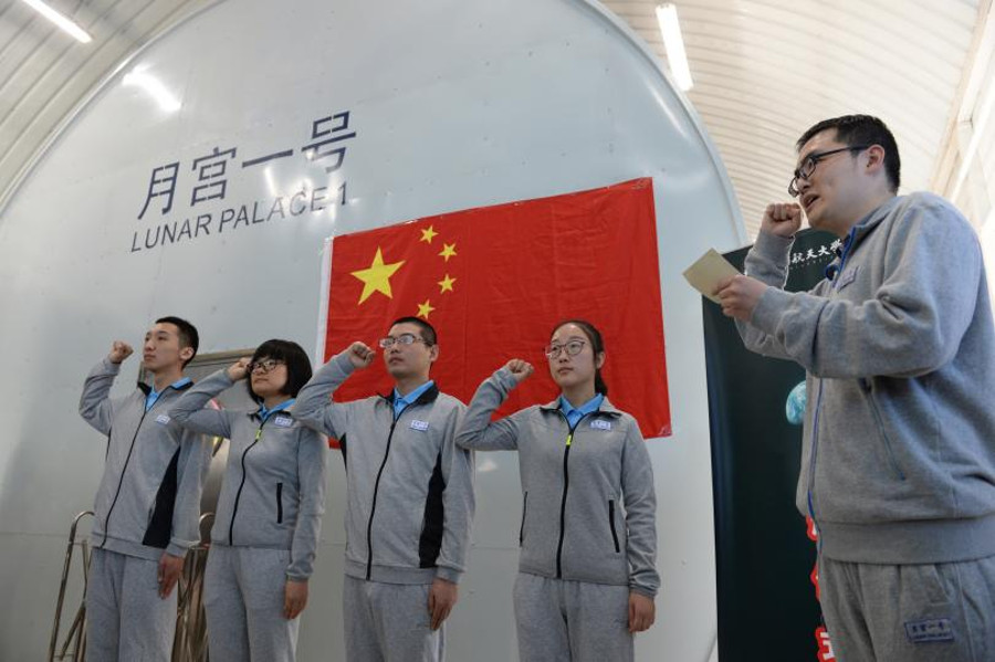 "The four volunteer students prepare for living in the Yuegong-1 or ""Lunar Palace."" Image Credit: STR/AFP/Getty Images"