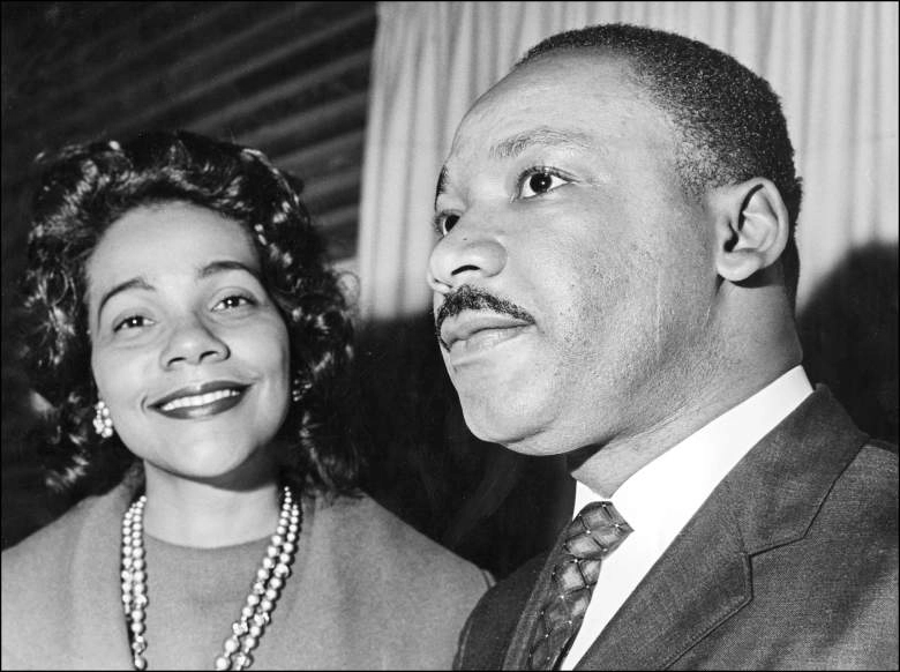 Coretta Scott King, who received threats from Father Aitcheson, next to her husband Dr. Martin Luther King. Image Credit: Heavy.com
