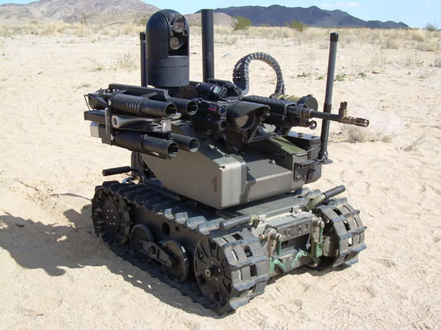 The Modular Advanced Armed Robotic System (MAARS), loaded with non-lethal laser dazzlers and audio deterrents, less-than-lethal grenades, menacing grenade launchers, and medium machine guns. Image Credit: QinetiQ / CNET
