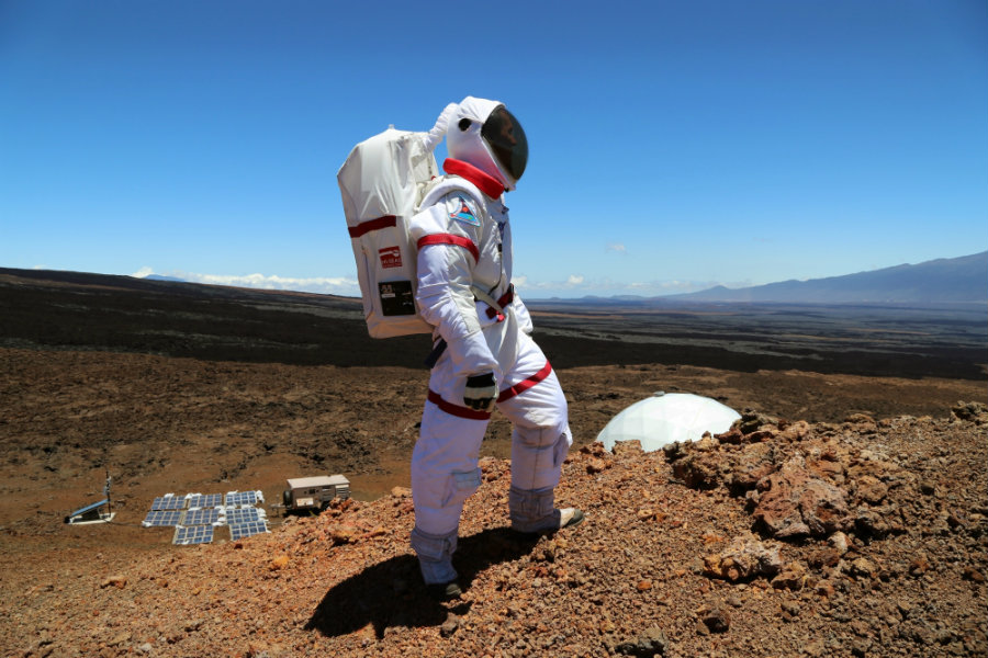 The NASA team wore a very advanced suit that let the base-scientists study when the astronauts were in a good or bad mood. Image credit: Vox