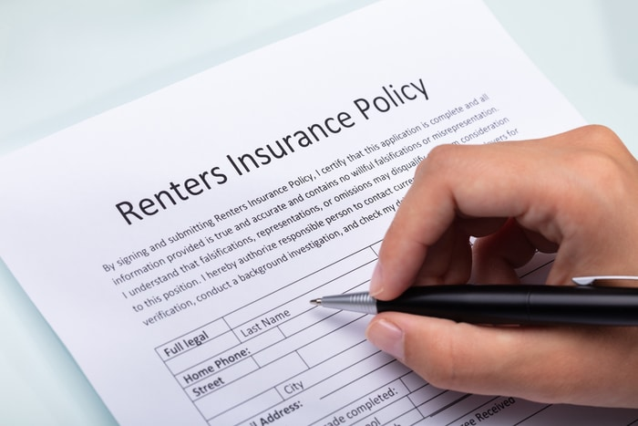 Person Filling Renters Insurance