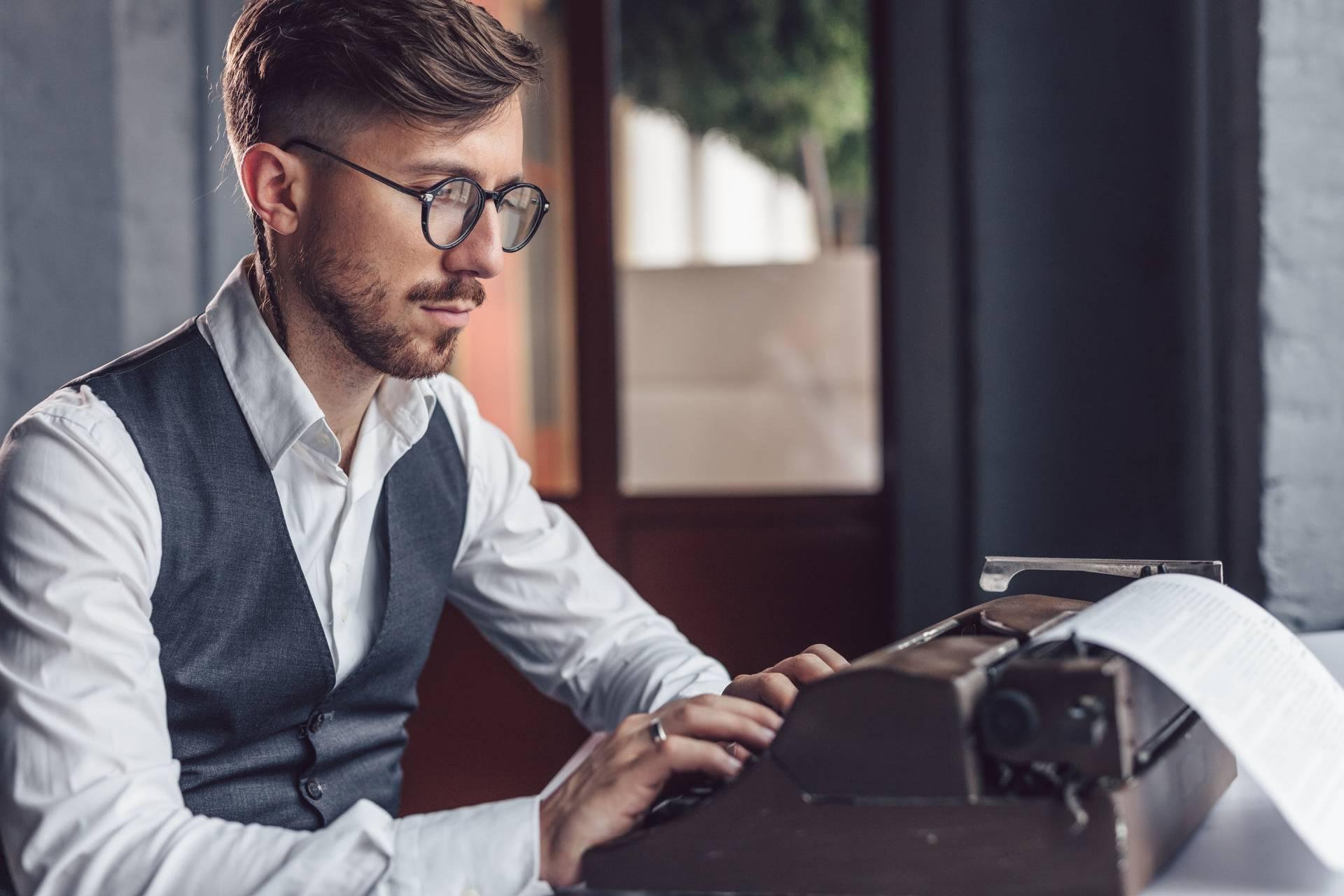 Man Typing on Typewriter
